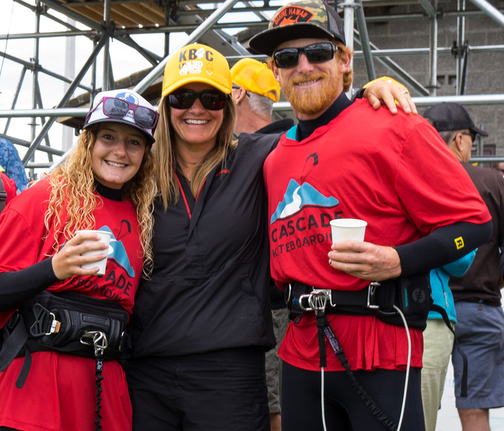 Cascade Kiteboarding staff Katie Noblett, Tonia Farman, and Justin Menasco volunteer at Kiteboard 4 Cancer.
