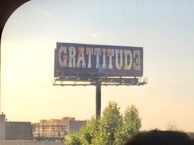 "This billboard is by pop artist Peter Tunney, who added the extra ""T"" as an expression of, he says, turbo-charged gratitude."