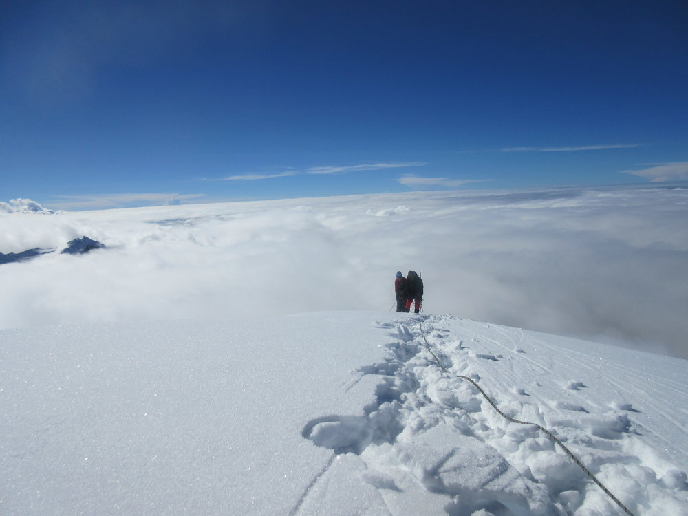 From the summit of Mera Central, an Austrian and her guide.