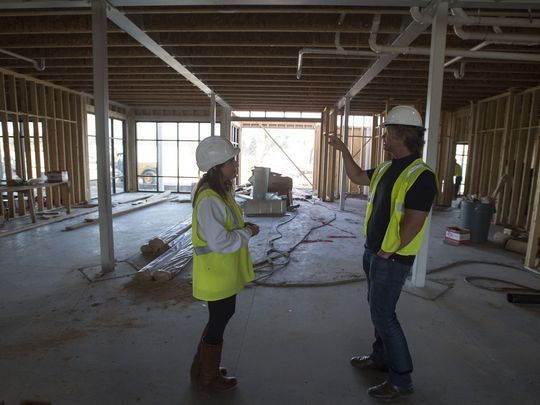 """Senior vice president of development with Spirit Hospitality Moira Bright, left, and Studio PBA director of hospitality Edwin Mocke walk through what will be the main lobby on Tuesday, April 17, 2018, at the construction site of a Spirit Hospitality hotel at Lady Moon Drive and East Harmony Drive in Fort Collins, Colo. (Photo: Timothy Hurst/The Coloradoan)"""