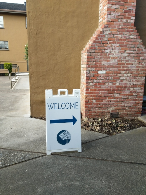 Single-sided sign in breezeway.