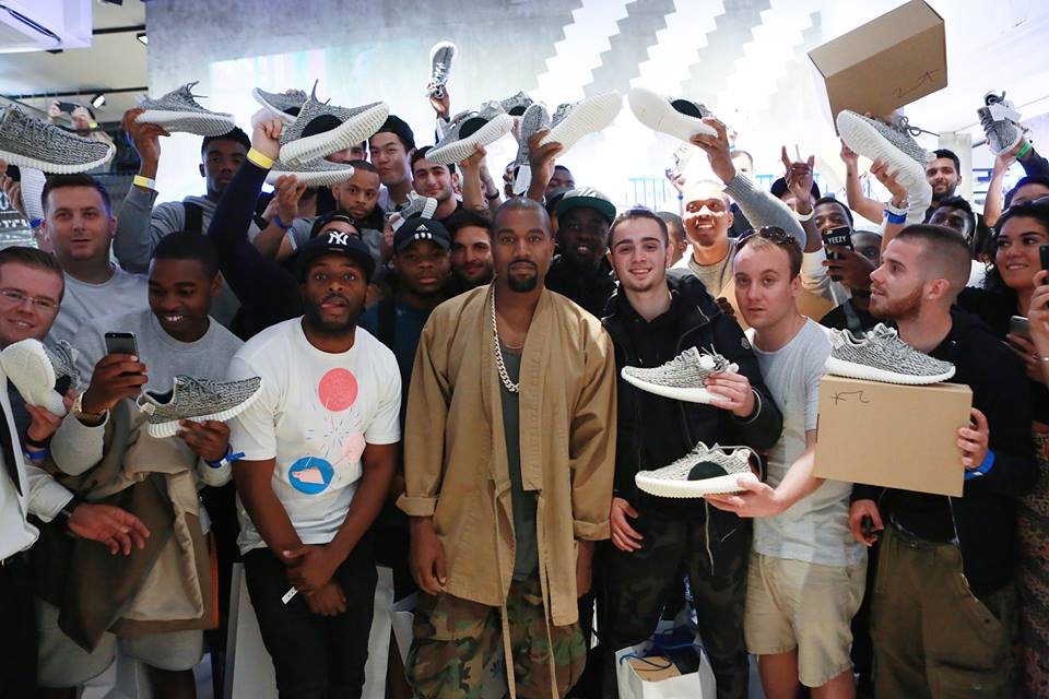 kanye west celebrates the launch of yeezy boost 350 at the adidas originals store in london ( via )