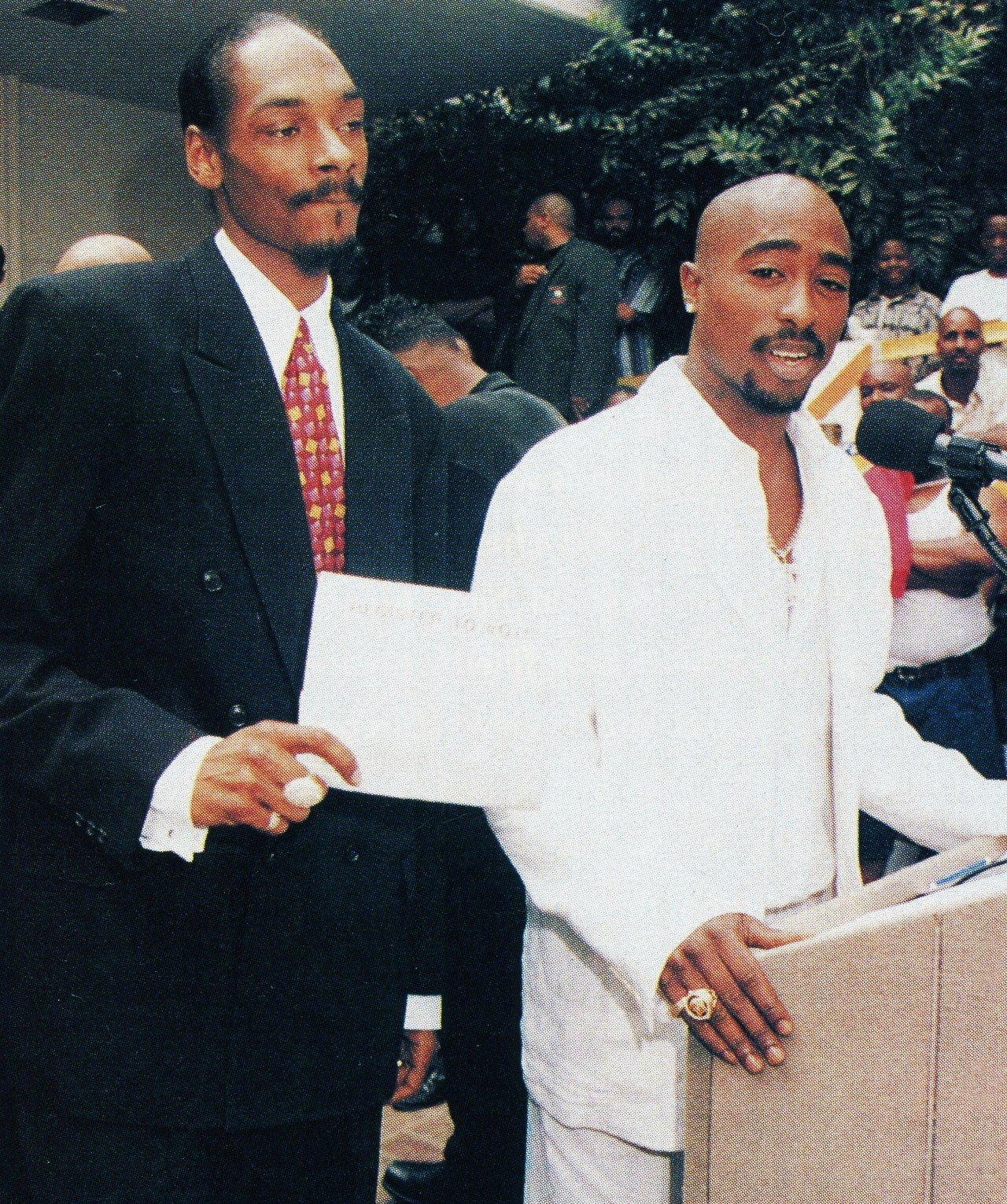vivalatupac :     15 Aug 1996 with Snoop Dogg at the Brotherhood Crusade Rally photographed by Bill Jones