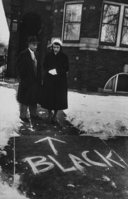 black-culture :     A couple who moved into an all-white neighborhood in Chicago looking at graffiti in front of their home. Photograph by Francis Miller. Chicago, Illinois, USA, 1957