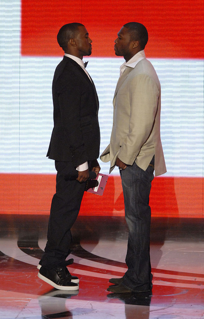 cidneybug13 :      dreamerzone :     Ye Soared…50 Cent crashed     LmL… Ye on his tippy toes. Too Cute!      Damn 50 Fell Off…