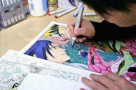 Kishimoto drawing his iconic characters NARUTO and SASUKE