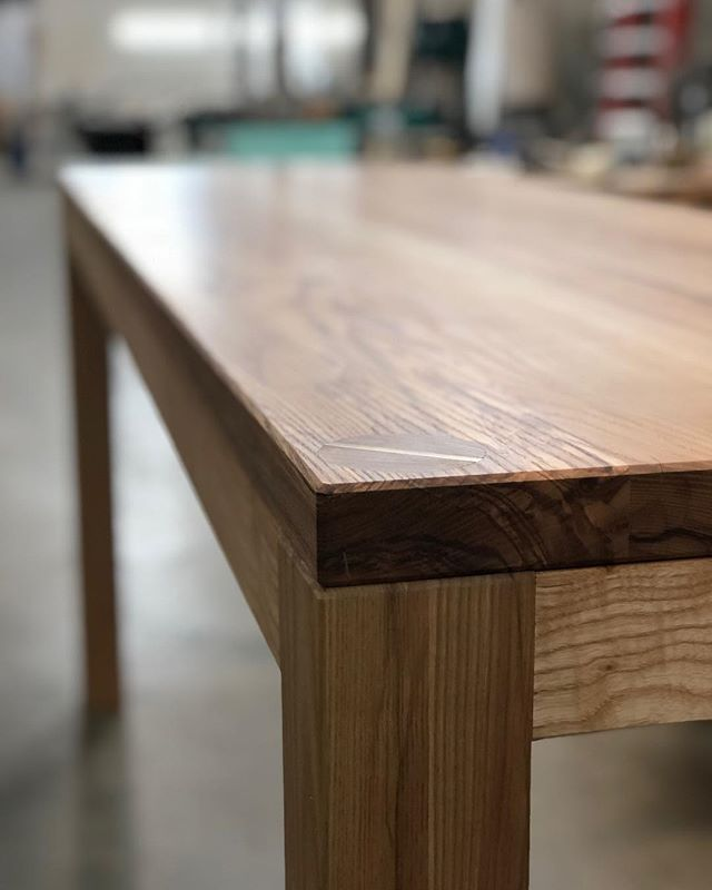 This custom table was a joy to design and make. We are excited to see how it looks in @manresabread 's new space!  The through tenons have a brass wedge that looks killer with the warm ash tone from @rubiomonocoatusa pure.  And for all you woodworkers worried about wood movement dm me and I'll share with you why this piece is stable and will last a very long time.  #restaurantdesign #interiordesign #interiordesigner #handmade #throughtenon #brass #ash #hardwood #raleigh #chapelhill