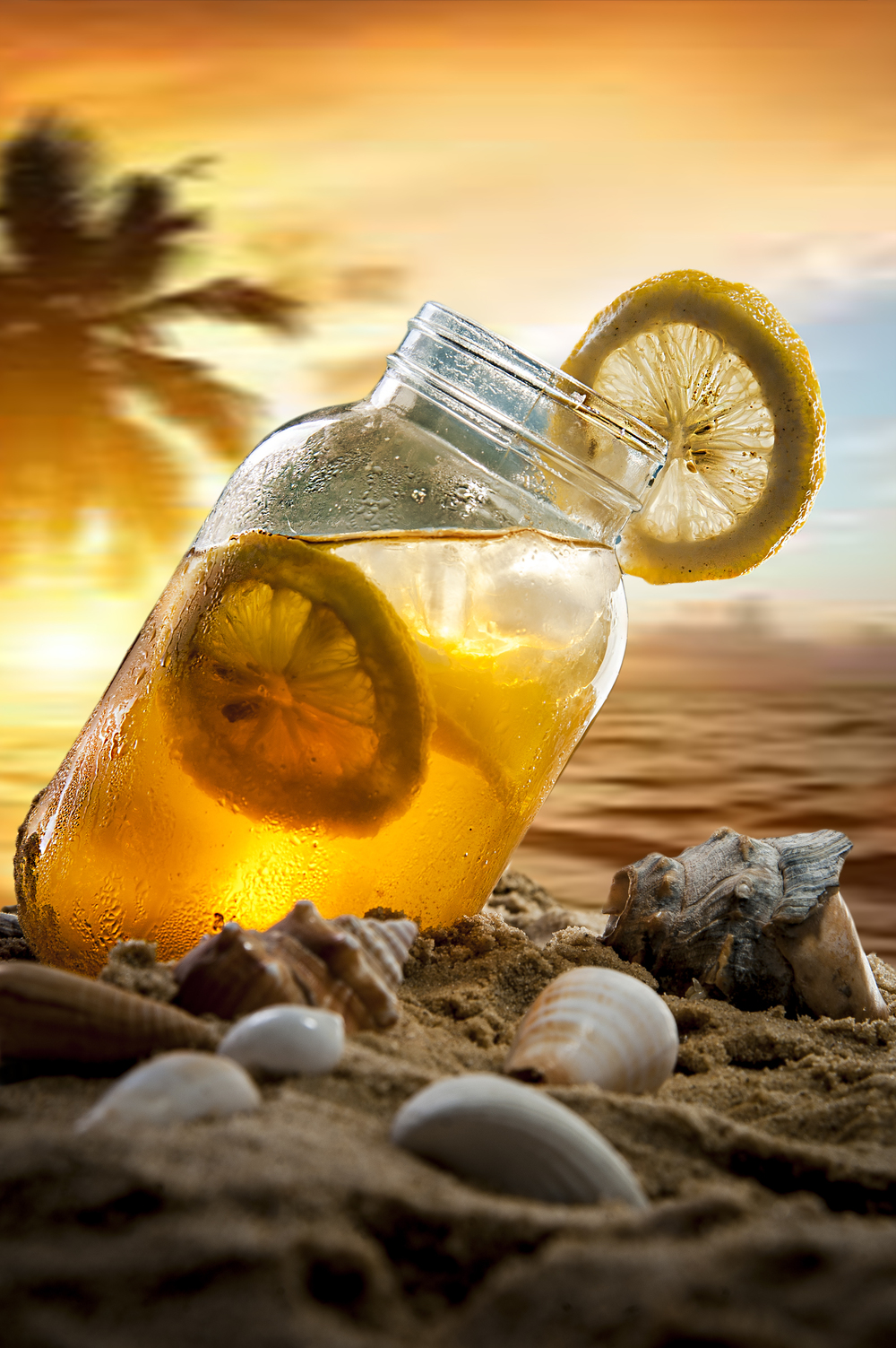 """<alt=""""Jusphotography commcerical Photography Ice cold refreashing Ice tea on beach"""" >"""