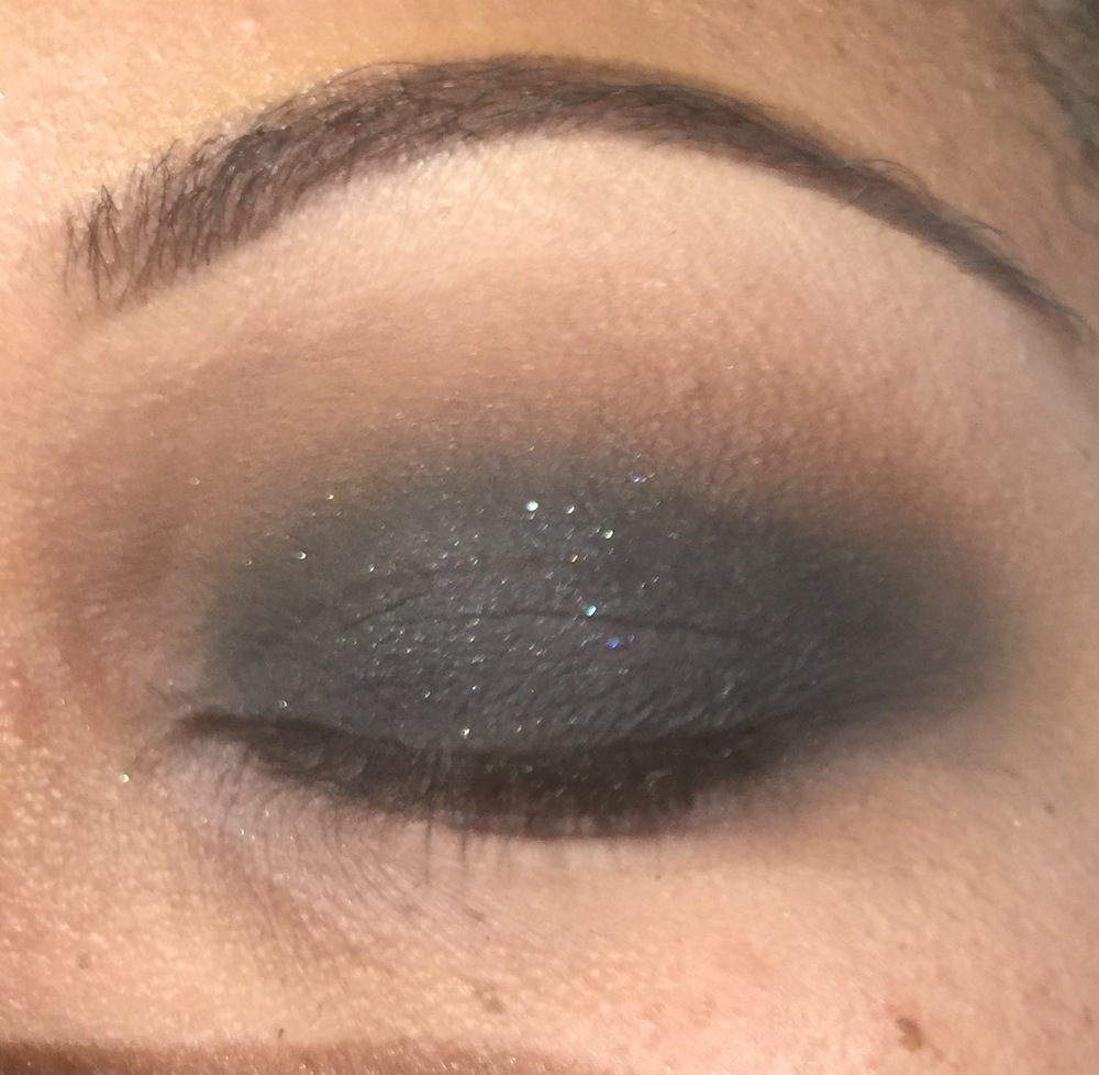 Step Four: Take a brown eyeshadow  with your crease brush and apply the shadow to your crease  and upper lid ( do not go all the way to your brow bone) and using a windshield wiper motion, blend the brown into the crease where the black ended. This motion will blur the hard line of black and fade into brown. You should blend until there is a gradient effect of black into brown.  If you feel that you need to add more black to your lower lid, feel free and repeat the step above with the brown eyeshadow. Blend until there are no harsh lines.  I used Chestnut by Makeup Forever.