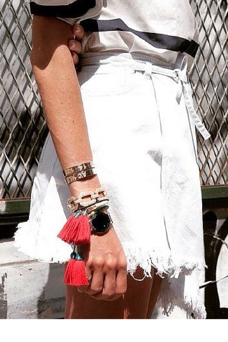 sneakers and pearls, street style, white denim skirt with a silk shirt for a smart casual look, accessorise your wrist, the more the better, trending now.png