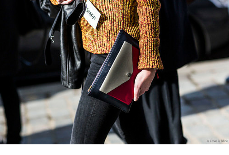 sneakers and pearls, streetstyle, burnt orange jumper, black leather jacket, black jeans, trending now, la cool et chic.png