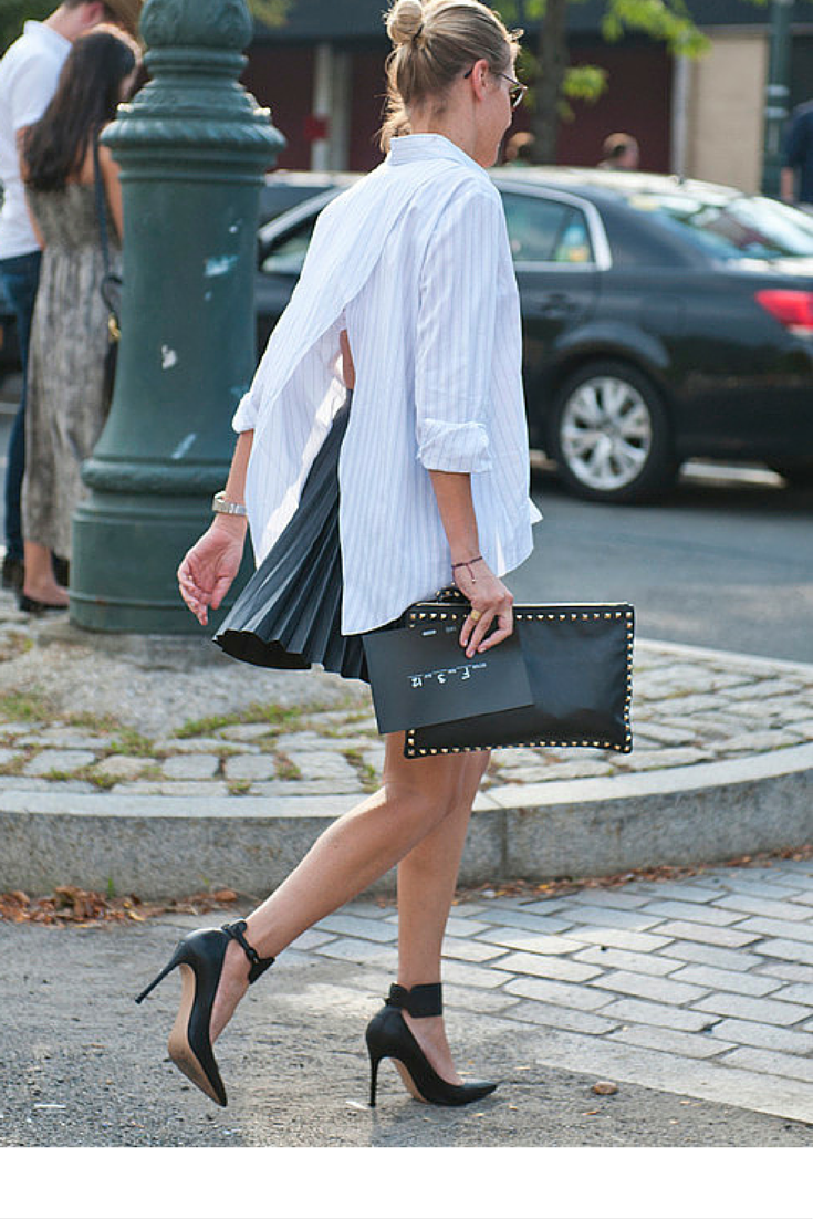 sneakers and pearls, black pleeted skirt, open back cotton stripy shirt,streetstyle, fashion, trending now, black leather clutch,fall in whatever.png