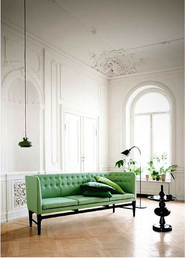 sneakers and pearls, homes to live in and have fun, green sofa is an unexpected touch in white spaces, trending now.png