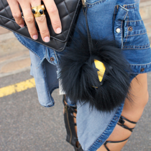 sneakers and pearls, street style, gold ring with onyx, knee high gladiators, black fur monster, trending now.png