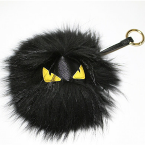 sneakers and pearls, black fur monster keyring, trending nowpng.png