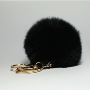 Extremely soft fluffy rabbit fur pompon that promises to give your bag a feminine yet playful twist. Use it as a keyring if you don't want to forget your keys again.