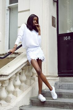 sneakers and pearls, street style, total white look, white lace skirt, white sneakers, trending now.jpg