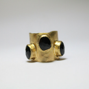 sneakers and pearls, gold ring with black onyx, trending now.png