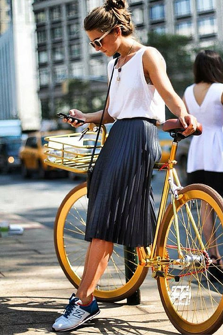 sneakers and pearls, street style, team up your pleated skirt with a white singlet, sneakers and a bicycle for around the city, trending now jpg.jpg