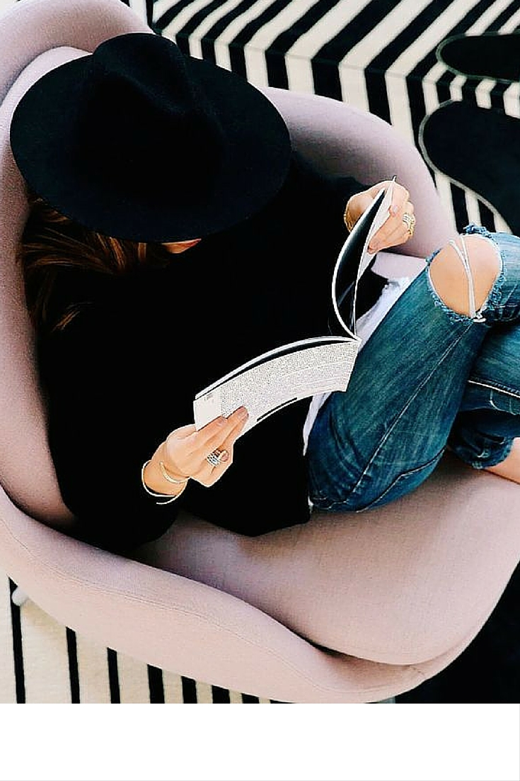 sneakers and pearls,book reading in style, distressed jeans, black felt hat, trending now.jpg