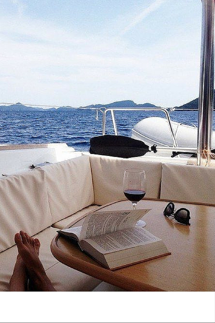 sneakers and pearls, boats to relax on, read a book in the peace of the sea, trending now.jpg