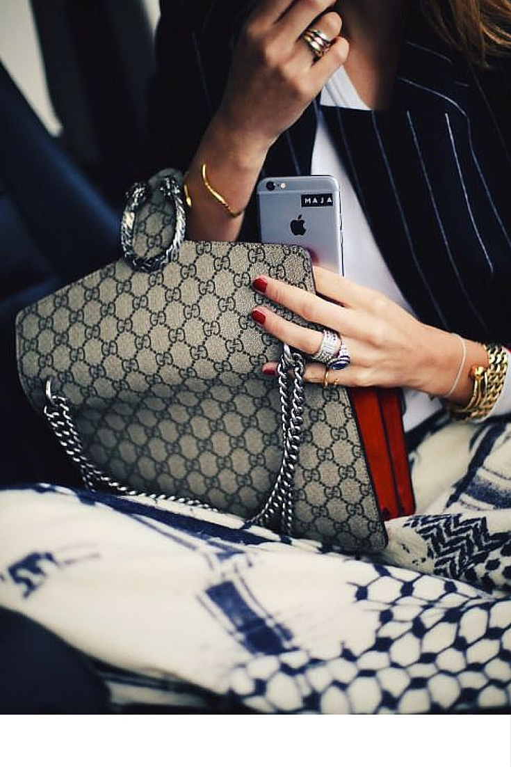sneakers and pearls, gucci bags, red nails and stripy navy blazers, trending now.jpg