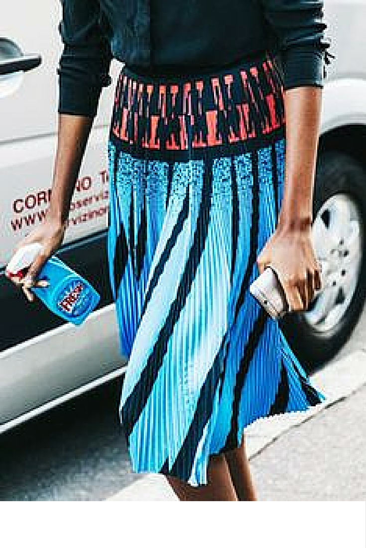 sneakers and pearls, street style, blue pleated skirt with a black shirt and a trendy phone case, trending now..jpg