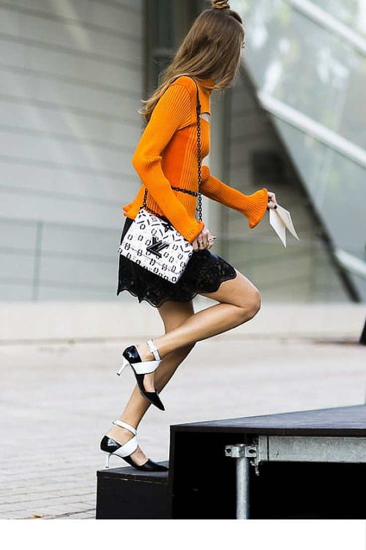 sneakers and pearls, street style, louis vuitton handbag, black and orange ensemble, pointy heel shoes, trending now.jpg