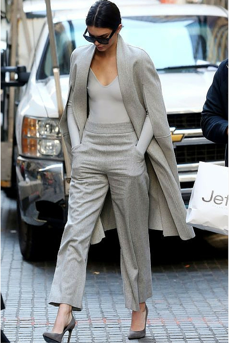 sneakers and pearls, street style, Kendal Jenner, grey suit, grey suede heels, trending now.jpg