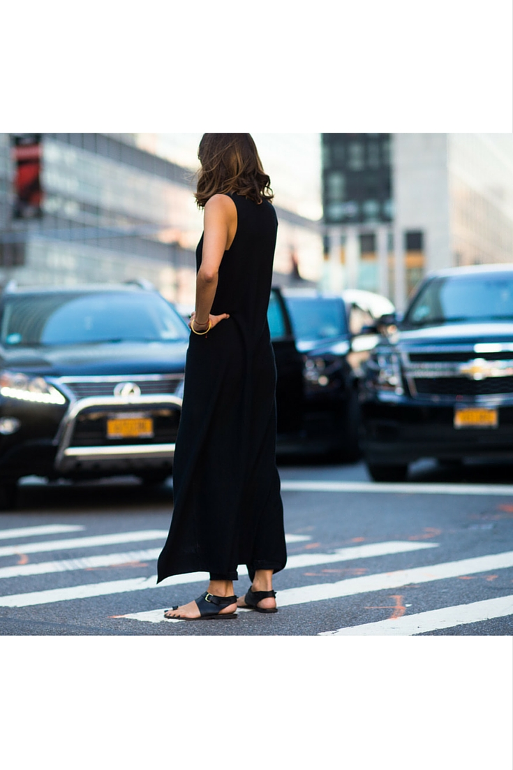 sneakers and pearls, street style, total black putfit, dress over pants ad black flat sandals, trending now.jpg