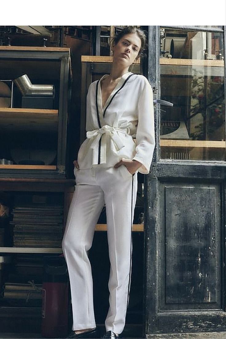sneakers and pearls, fresh take on the pyjama look, white pants with a black pipping, trending now.jpg