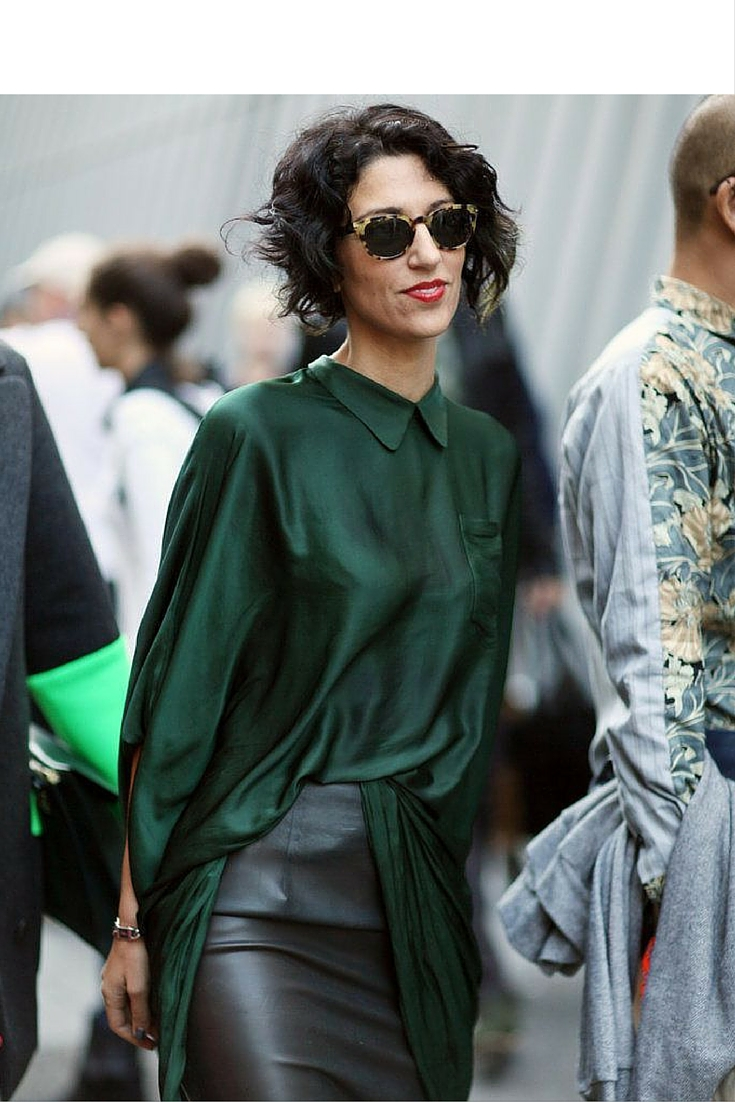 sneakers and pearls, street style, black leather skirt with green silk long top, wear your dress as a top by tacking in one small bit, trending now..jpg