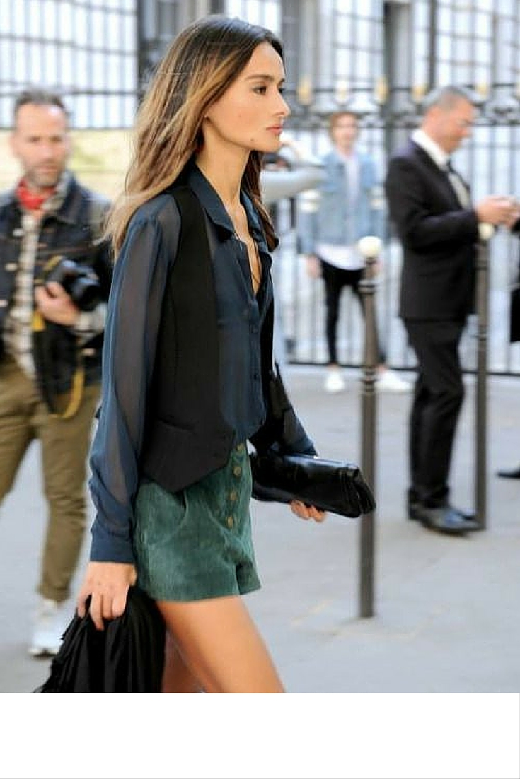 sneakers and pearls, street style, black classic vest over a sheer shirt and suede shorts, trending now.jpg