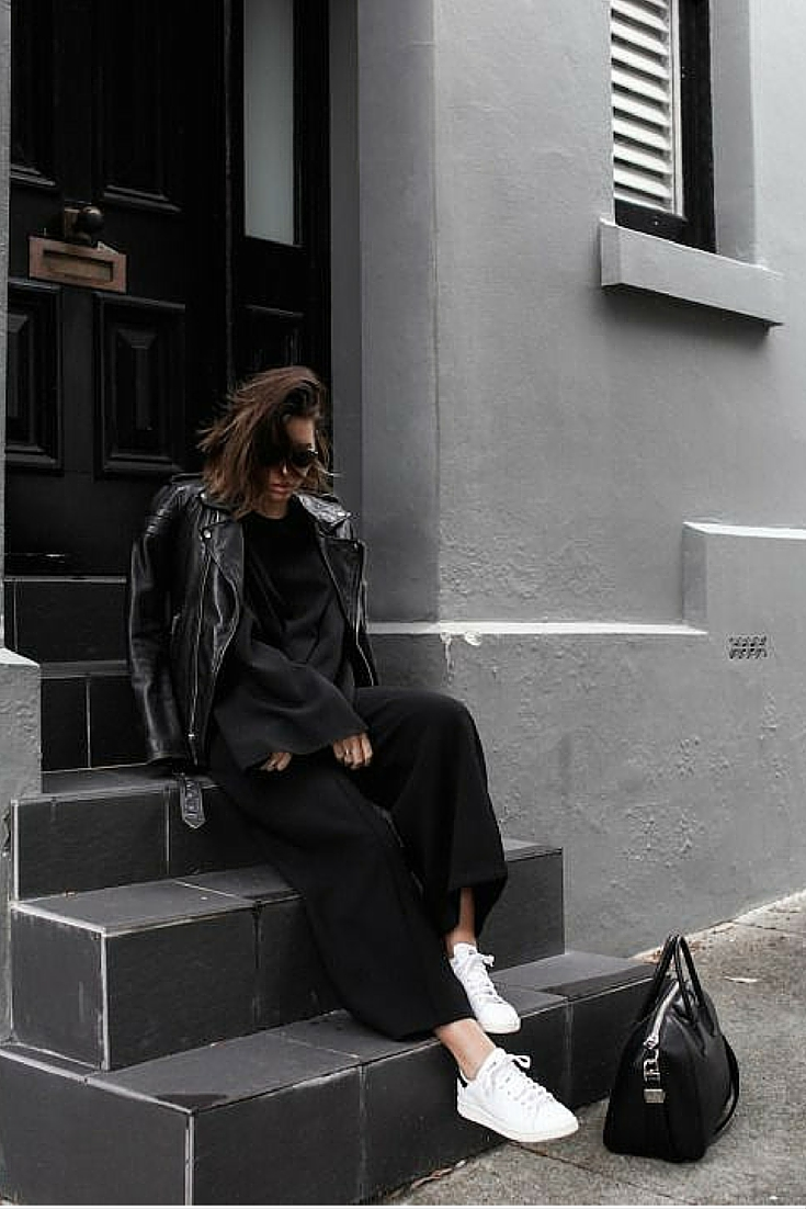 sneakers and pearls,street style, black wide pants and a black top with a leather jacket for an effortlesssly cool look, Givenchy bag, wear white sneakers with everything , trending now.jpg