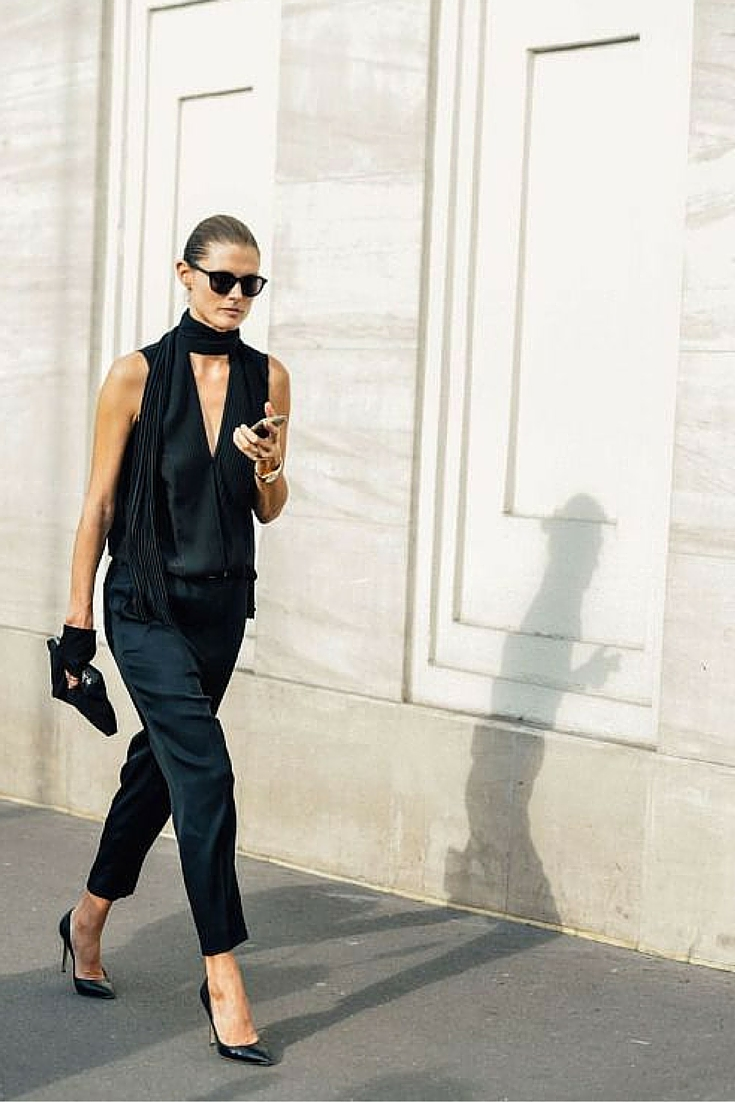 sneakers and pearls,total black outfit, black ankle pants, black top with a black thin scarf, trending now.jpg