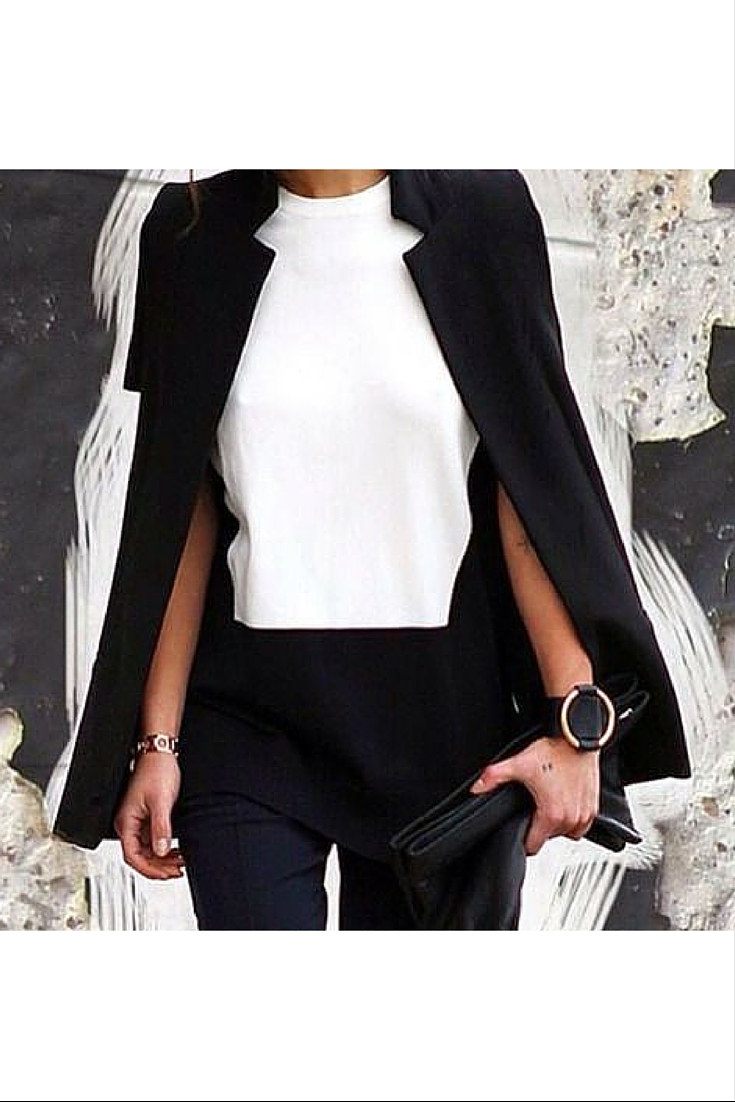 sneakers and pearls,black pant suit with a two tone top, black clutch, black leather cuff, trending now.jpg