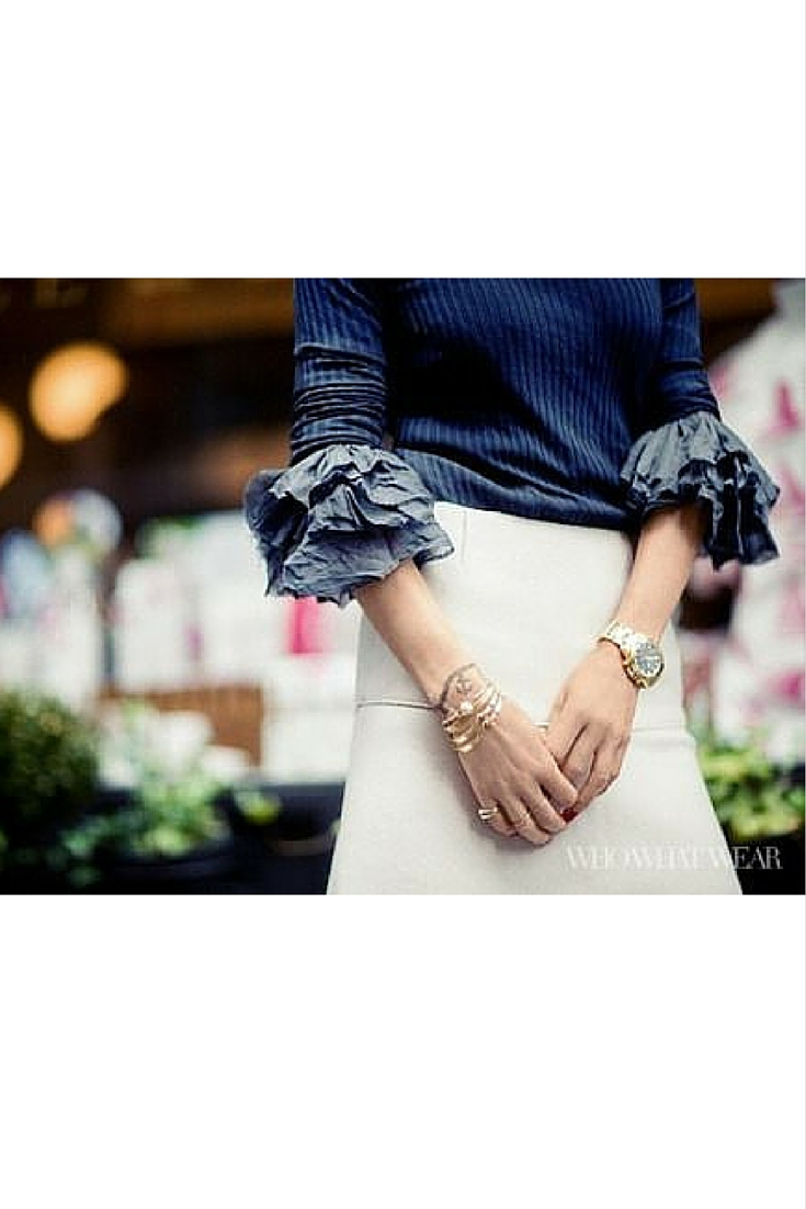 sneakers and pearls, street style, cream floaty skirt with a blue knit, layer a frilly shirt with a knit, trending now.jpg