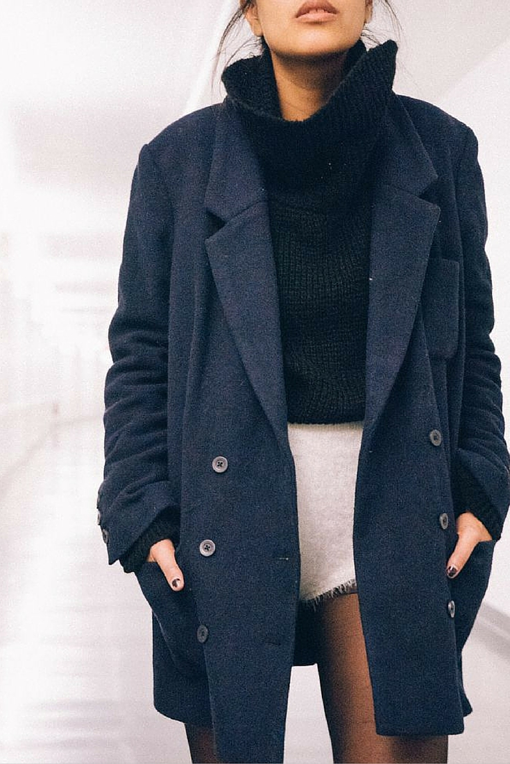 sneakers and pearls, tsuper short shorts layered with a coat, navy coat, trending now.j.jpg