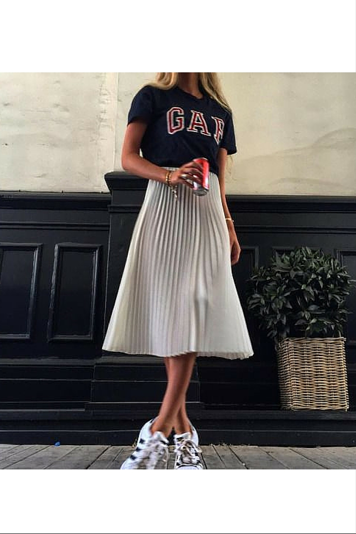 sneakers and pearls, street style, wear a pleat skirt with a t-shirt and sneakers for a casual look, trending now.jpg