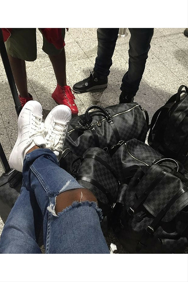 sneakers and pearls, airport style, louis vuitton luggage, trending now.jpg