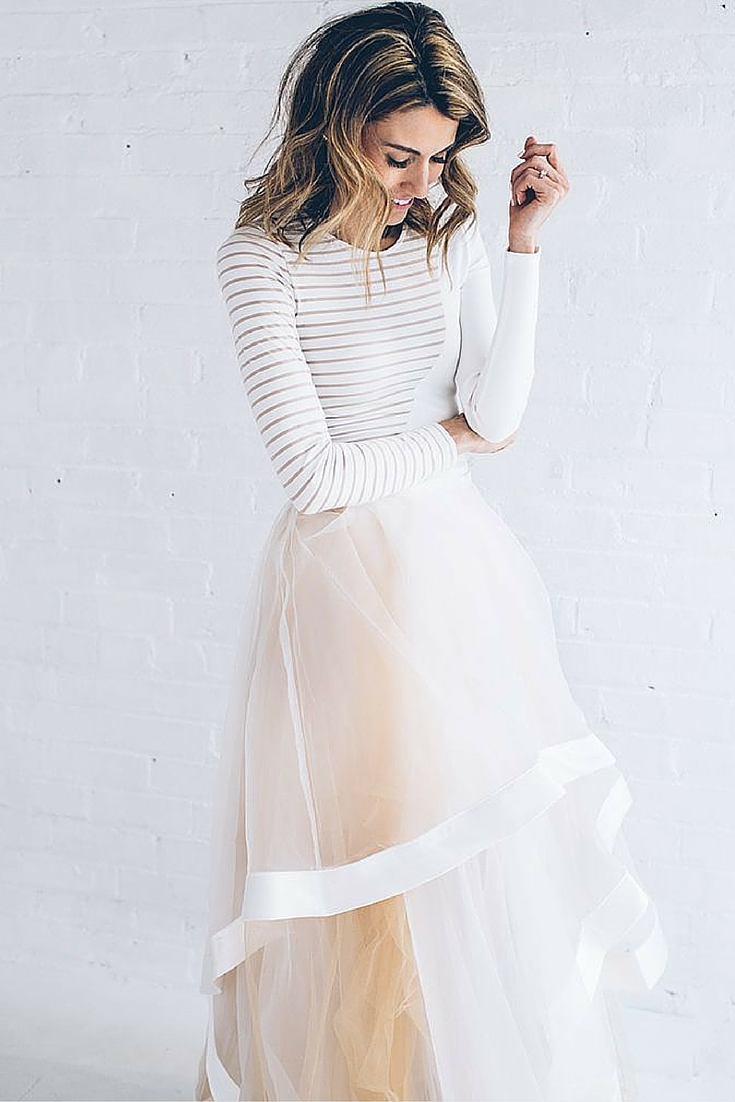 sneakers and pearls, white fitted top with a chiffon white skirt, trending now.jpg