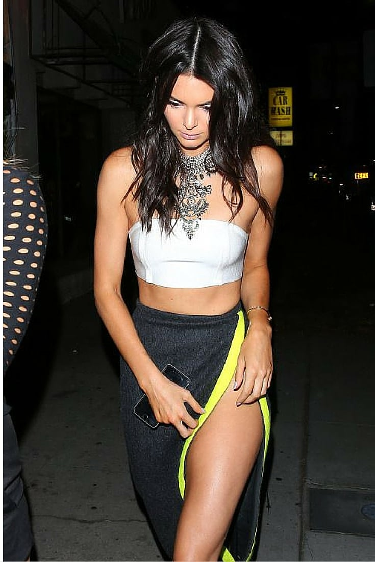 sneakers and pearls, kendal jenner, high split skirt, costume jewellery, cropped top, trending now.jpg