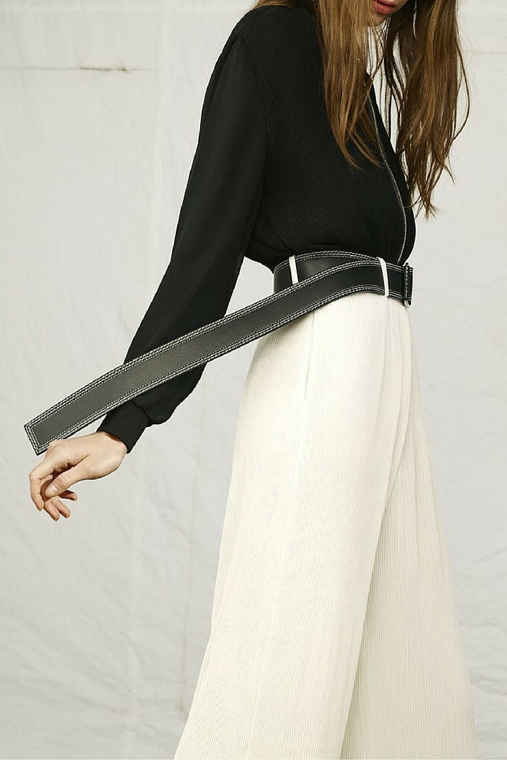 sneakers and pearls, white wide pants, long black belt, trending now.jpg