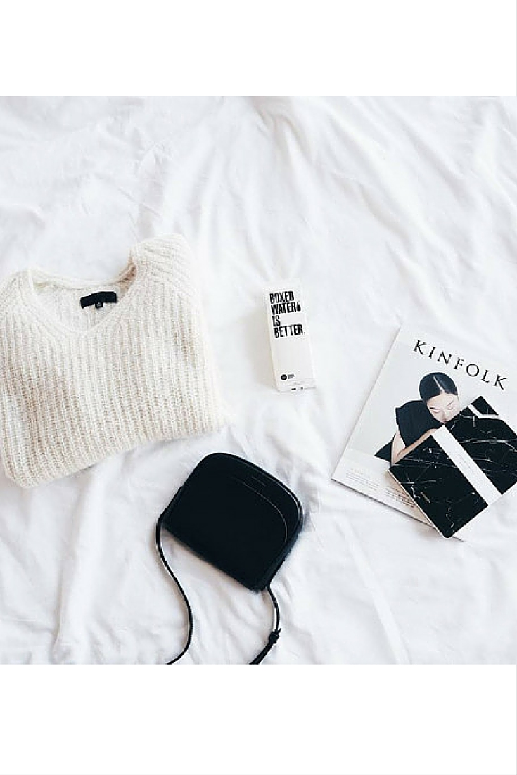 sneakers and pearls, oof duty  models' essentials, flatlay, black leather shoulder bag, cream jumper, trending now.jpg