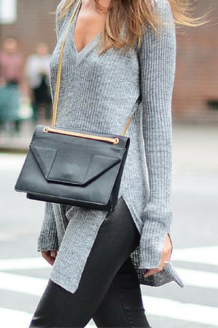 sneakers and pearls, new york city, street style, black leather pants with a grey long jumper, winter, always trending.jpg