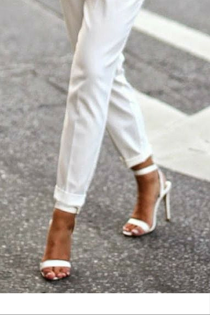 sneakers and pearls, street style, office wear, white pants with a stripy top and gold accessories and white heeled sandals, always trending.jpg
