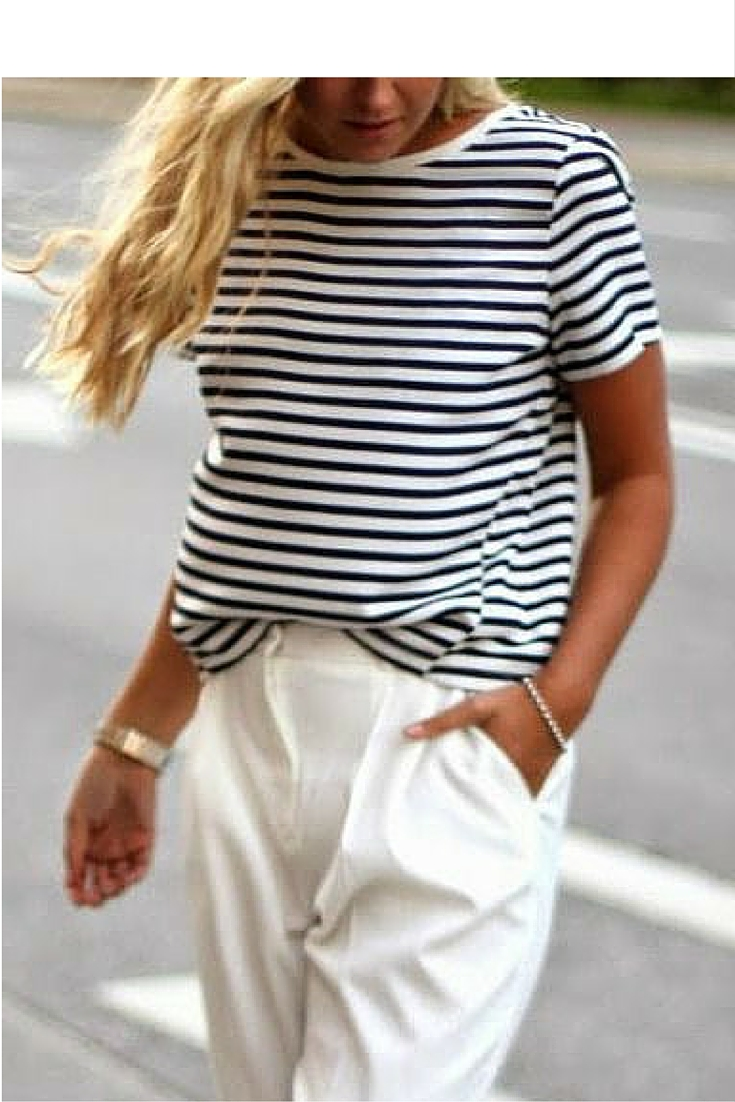 sneakers and pearls, street style, office wear, white pants with a stripy top and gold accessories, always trending.jpg