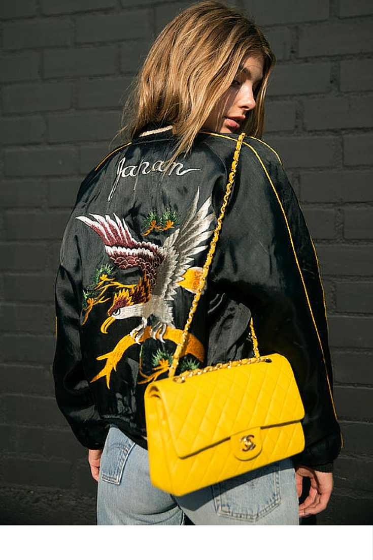 sneakers and pearls, street style, jeans with a silk bomber jacket and an arm candy, yellow chanel bag, trending now.jpg