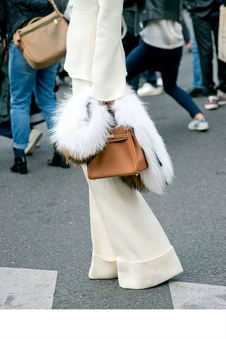 sneakers and pearls, street style, bell bottom wide pants, white in the middle of winter, hermes bag, trending now.jpg
