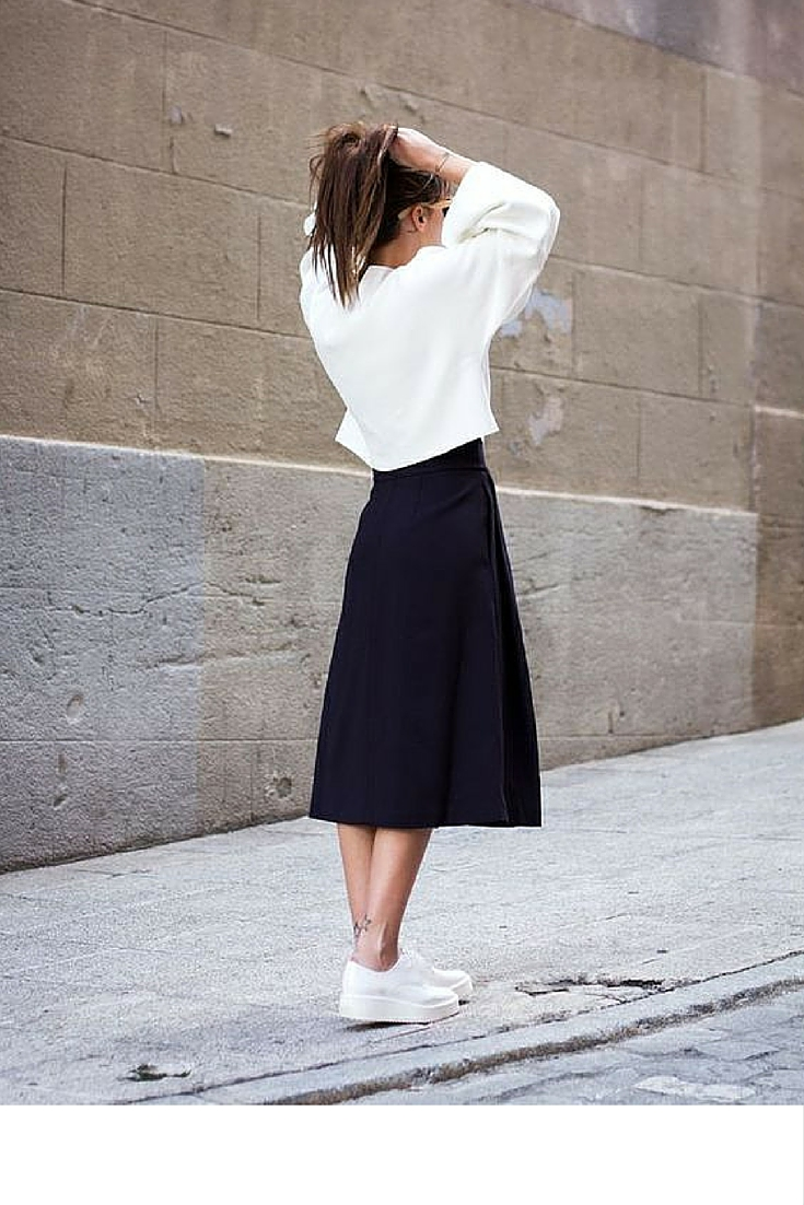 sneakers and pearls, street style new york fashion week, black a line midi skirt, white oversized top, fancy brogues, trending now.jpg